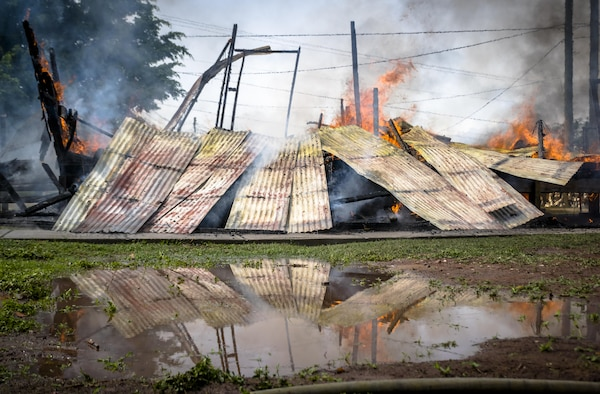The hooch begins to crumble as it burns down. The 612th Air Base Squadron Fire Department host a public fire training at Soto Cano Air Base, June 16, 2017.