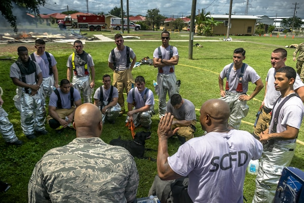 Master Sgt. Corey T. Coleman gives a debrief after the exercise. The 612th Air Base Squadron Fire Department host a public fire training at Soto Cano Air Base, June 16, 2017.