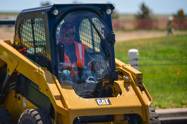 Contractors from Mirador-Nasco begin reconstruction of the 6th Avenue Gate June 13, 2017, on Buckley Air Force Base, Colo. The project is expected to help with traffic calming and address anti-terrorism force protection concerns. (U.S. Air Force photo by Airman Jacob Deatherage/Released)