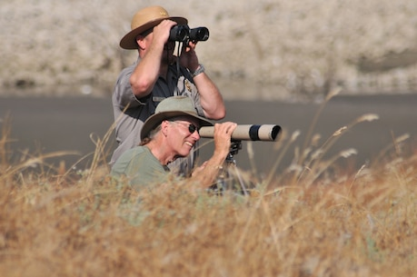 A pair takes a closer look at the wide variety of birds at H.V. Eastman Lake.