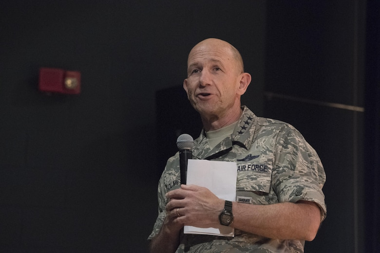 Gen. Mike Holmes, commander of Air Combat Command, speaks about his priorities during an all call at Joint Base Langley-Eustis, Va., June 20, 2017. The three priorities Holmes listed are improving squadron readiness, building leaders and bringing the future faster. (U.S. Air Force photo by Staff Sgt. Nick Wilson)
