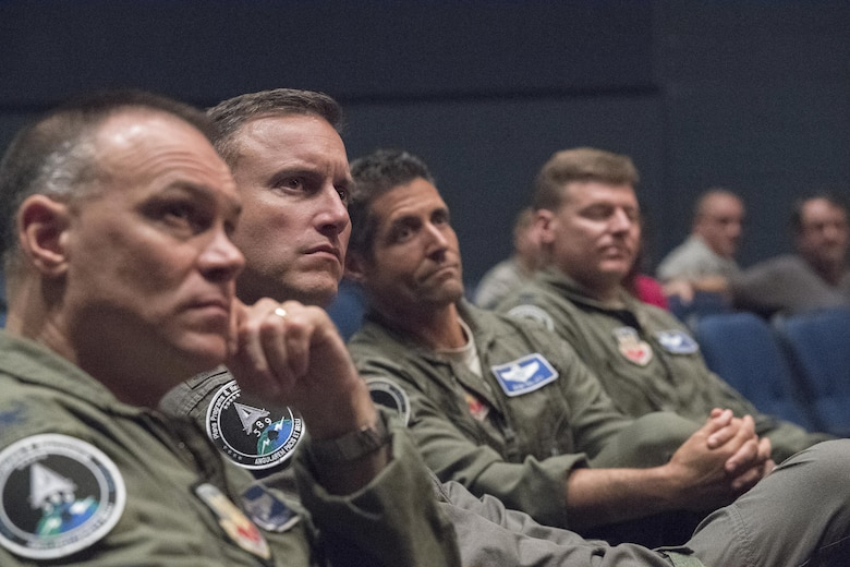 Command staff members from Air Combat Command listen to Gen. Mike Holmes, commander of ACC, during his speech about Airmen and family support programs at an all call at Joint Base Langley-Eustis Va., June 20, 2017. During Holmes' presentation, he also emphasized the importance of communication up and down each squadron's chain of command. (U.S. Air Force photo by Staff Sgt. Nick Wilson)
