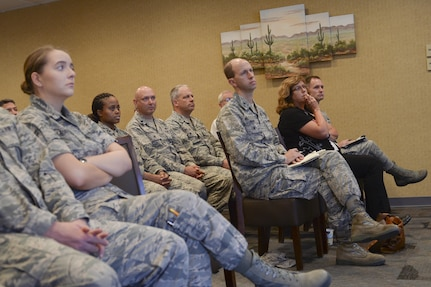 Members of 12th Air Force (Air Forces Southern) and University of Arizona listen as Colin Deeds, University of Arizona Latin American Studies Center assistant director, lectures during a speaker series event at Davis-Monthan Air Force Base, Ariz., June 19, 2017, for the 12th Air Force (Air Forces Southern) Academic Outreach Program with the University of Arizona. The Academic Outreach Program is modeled after U.S Southern Command's partnership with Florida International University. (U.S. Air Force photo by Staff Sgt. Angela Ruiz)