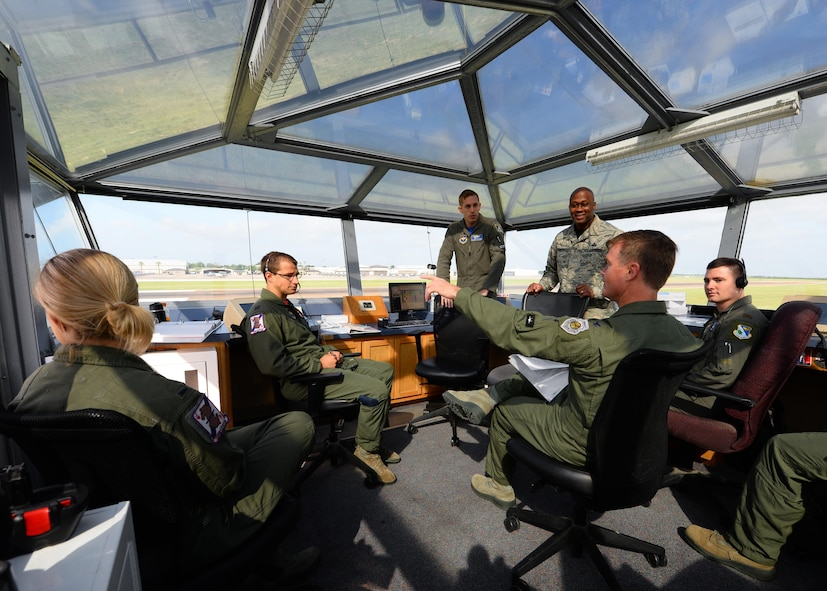 Col. Thomas Shank, 47th Flying Training Wing commander, discusses takeoffs and landings while visiting the Runway Supervisory Unit at Laughlin Air Force Base, June 16, 2017. Leadership had an opportunity to spend time and learn more of what the Airmen do on a day-to-day basis. (U.S. Air Force photo/Airman 1st Class Benjamin N. Valmoja)