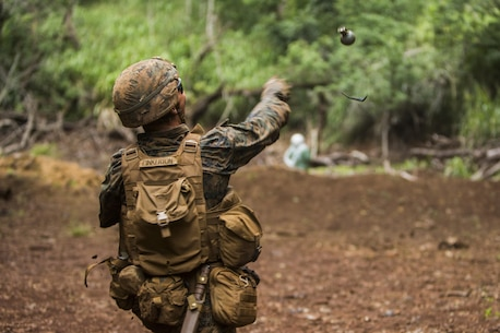 SCHOFIELD BARRACKS – A Marine with India Company, 3rd Battalion, 3rd Marine Regiment, throws an M69 training grenade during a live-fire and maneuver exercise at Range 3 at Schofield Barracks, June 18, 2017. Marines with 3/3 take part in Bougainville Exercise 1-17.2, a two-week training exercise to help improve their tactics and skill as infantry Marines. (U.S. Marine Corps photo by Lance Cpl. Isabelo Tabanguil)
