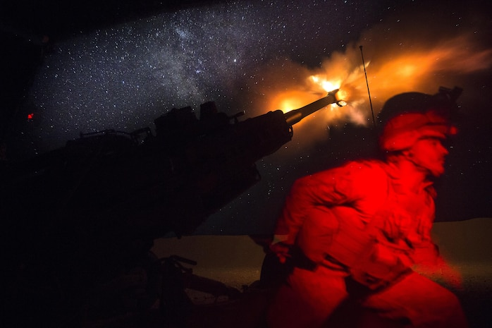 A U.S. Marine fires an M777-A2 Howitzer in the early morning in Syria, June 3, 2017. They have been conducting 24-hour all-weather fire support for the Coalition's local partners, the Syrian Democratic Forces, as part of Combined Joint Task Force-Operation Inherent Resolve. CJTF-OIR is the global coalition to defeat ISIS in Iraq and Syria.