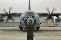 U.S. Marine Corps Sgt. Ryan Flores, a crew master with Marine Aerial Refueler Transport Squadron 152, guides a KC-130J Hercules into a set of hot refuel pits at Marine Corps Air Station Iwakuni, Japan, June 20, 2017. U.S. Marines, U.S. Sailors and Master Labor Contractors with Headquarters and Headquarters Squadron fuels division conducted a proof of concept for hot refueling in order to test for safety and ensure all equipment functioned properly. Pending approval from the air station's commanding officer and the Defense Logistics Agency, the rebuilt hot refuel pits will allow aircraft to rapidly refuel without powering down their engines, which increases operational readiness.