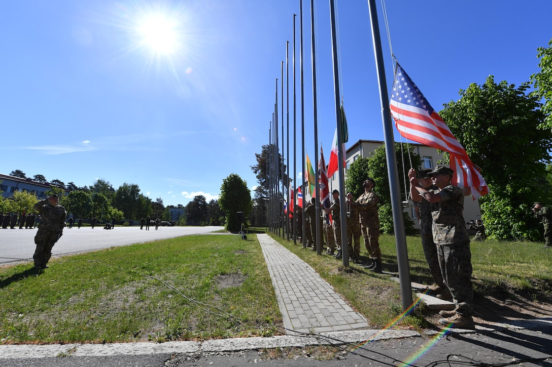 U.S. and NATO military members raise their countries' flags during the opening ceremony for exercise Saber Strike 17 at Adazi Military Base, Latvia, June 3, 2017. 11,000 U.S. and NATO military members from 20 countries participated in the exercise from May 28 to June 24 throughout the Baltics and Poland. Saber Strike 17 promotes regional stability and security, while strengthening partner capabilities and fostering trust. (U.S Air Force photo by Senior Airman Tryphena Mayhugh)