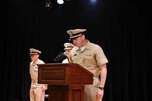 170615-N-TB177-0019 MANAMA, Bahrain (June 15, 2017) Lt. Cmdr. Robert Burke, former commanding officer of USS Devastator (MCM 6), reads his departing orders during a change of command ceremony at Naval Support Activity Bahrain. Devastator is the sixth of 14 Avenger-class mine countermeasures ships and the second ship to bear its name. (U.S. Navy photo by Mass Communication Specialist 2nd Class Kevin J. Steinberg)