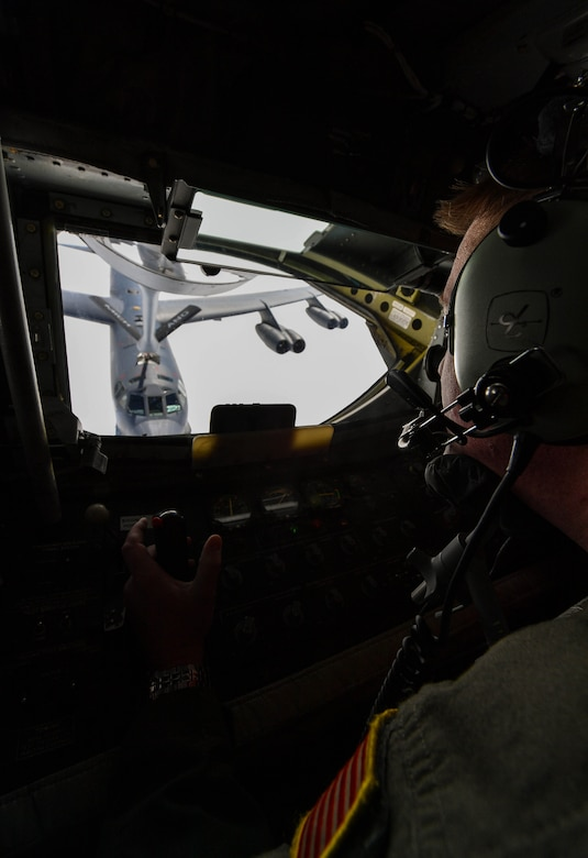 U.S. Air National Guard Tech. Sgt. Max Langford, 171st Air Refueling Squadron boom operator, refuels a U.S. Air Force Global Strike Command B-52 Stratofortress during exercise Saber Strike 17 above Riga, Latvia, June 13, 2017. Langford, along with other boom operators from the 171st ARS, refueled B-52s and B-1B Lancers throughout the exercise. The combined training opportunities that Saber Strike 17 provides greatly improves interoperability among participating NATO Allies and key regional partners. (U.S Air Force photo by Senior Airman Tryphena Mayhugh)
