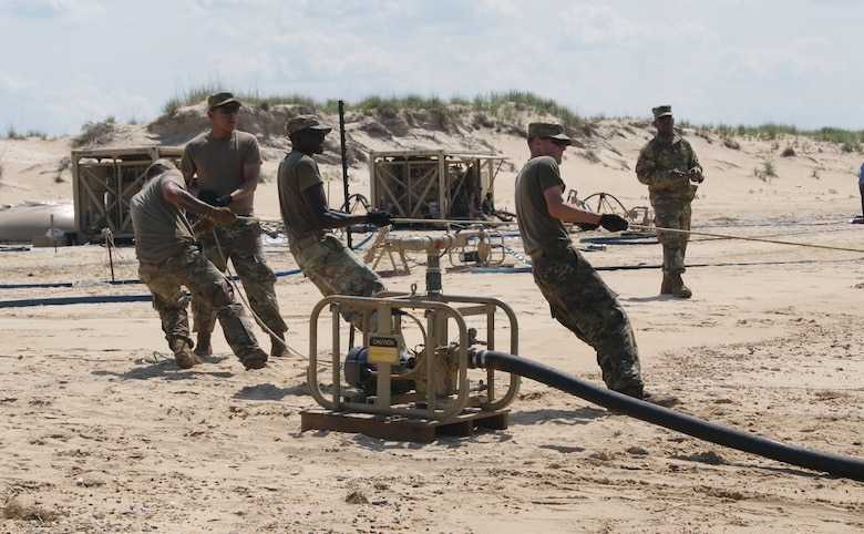 The water purification team from the 504th Composite Supply Company, out of Fort Bliss, Texas, tugs on the rope, preparing to capture salt water from the Atlantic Ocean during the Reverse Osmosis Water Purification Unit Rodeo at Fort Story, Virginia, June 12, 2017.