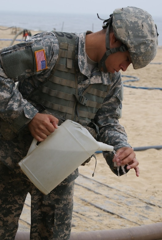 Sgt. Valentin Alvarez, a member of the 961st Quartermaster Company water purification team, tests the finished water product that his team purified during the Reverse Osmosis Water Purification Unit Rodeo at Fort Story, Virginia, June 15, 2017.