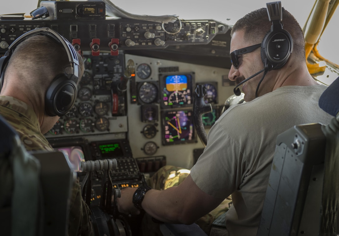 Two KC-135 Stratotanker pilots, assigned to the 340th Expeditionary Air Refueling Squadron, control the aircraft during a flight in support of Operation Inherent Resolve June 21, 2017. The 340th EARS, part of U.S. Air Forces Central Command, is responsible for delivering fuel to U.S. and coalition forces, enabling a 24/7 presence in the Central Command area of responsibility. (U.S. Air Force photo by Staff Sgt. Trevor T. McBride)