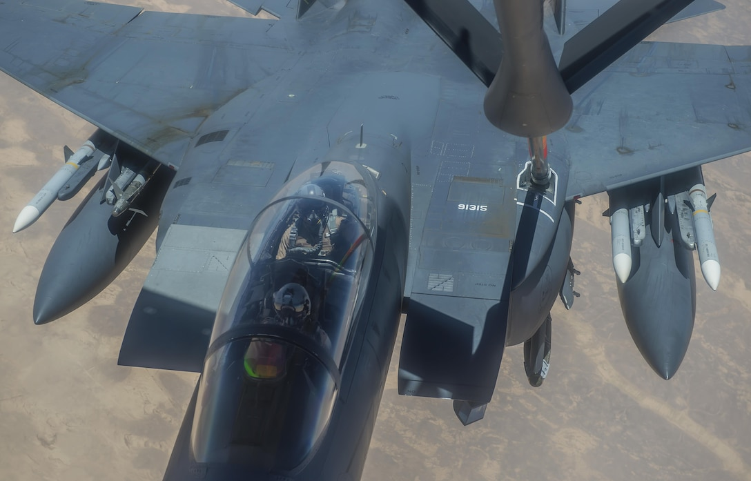 A U.S. Air Force F-15E Strike Eagle receives fuel from a 340th Expeditionary Air Refueling Squadron KC-135 Stratotanker during a flight in support of Operation Inherent Resolve June 21, 2017. The F-15, a component of U.S. Air Forces Central Command, supports U.S. and coalition forces working to liberate territory and people under the control of ISIS. (U.S. Air Force photo by Staff Sgt. Trevor T. McBride)