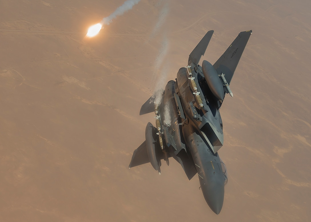 A U.S. Air Force F-15E Strike Eagle fires flares during a flight in support of Operation Inherent Resolve June 21, 2017. The F-15, a component of U.S. Air Forces Central Command, supports U.S. and coalition forces working to liberate territory and people under the control of ISIS. (U.S. Air Force photo by Staff Sgt. Trevor T. McBride)