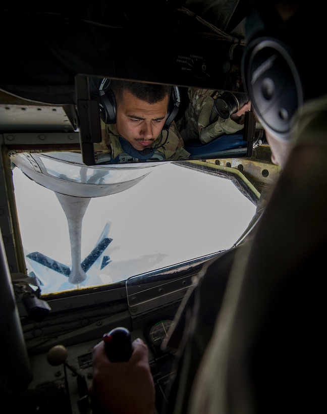 A boom operator, assigned to the 340th Expeditionary Air Refueling Squadron, refuels a U.S. Air Force F-22 Raptor from a KC-135 Stratotanker during a flight in support of Operation Inherent Resolve June 21, 2017. The 340th EARS, part of U.S. Air Forces Central Command, is responsible for delivering fuel to U.S. and coalition forces, enabling a 24/7 presence in the Central Command area of responsibility. (U.S. Air Force photo by Staff Sgt. Trevor T. McBride)