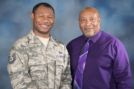 Tech. Sgt. Jesse Sills Jr. and Jesse Sills Sr. pose for a photo June 14, 2017 at Joint Base San Antonio-Randolph, Texas. Sills Jr. is the NCO in charge of first sergeant assignments at the Air Force Personnel Center, while Sills Sr. also works at AFPC as a human resources specialist. (U.S. Air Force photo by Sean Worrell)