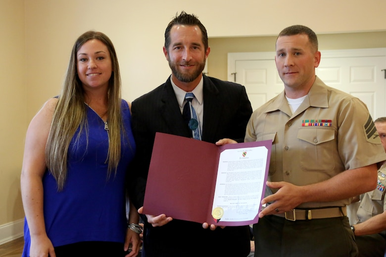A proclamation from the city of New Bern is given to Sgt. Shaun Monaghan and his wife Lindsay while being recognized as the Military Family of the Quarter during a luncheon at the New Bern, N.C., Golf and Country Club, June 9, 2017. The Monaghans have contributed hundreds of volunteer hours to the New Bern community. Shaun is an intermediate level ordnance instructor teaching hundreds of Marines at the Center for Naval Aviation Technical Training aboard Marine Corps Air Station Cherry Point, N.C. (Marine Corps photo by Cpl. Jason Jimenez/ Released)