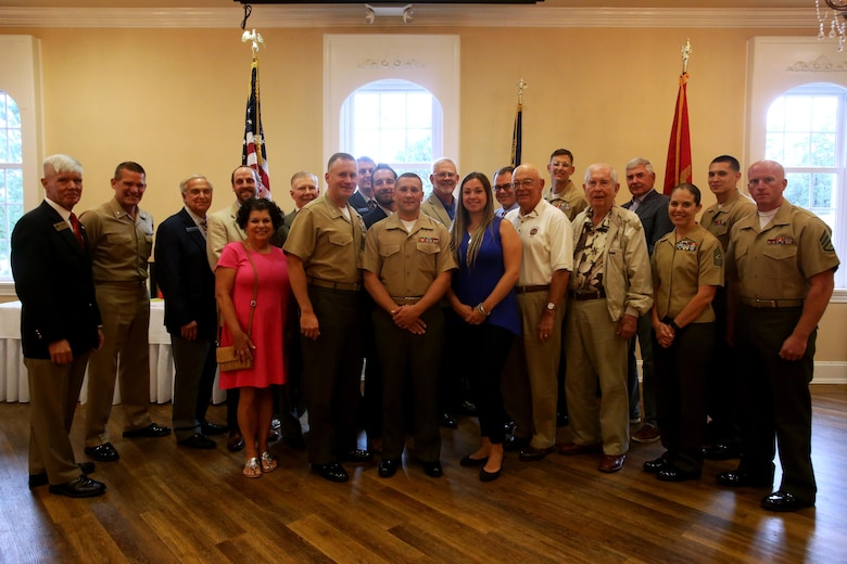 Members of the New Bern Military Alliance and Marine Corps Air Station Cherry Point senior leadership gathered during a during a luncheon in honor of the Military Family of the Quarter, Sgt. Shaun and Lindsay Monaghan, at the New Bern, N.C., Golf and Country Club, June 9, 2017. The Monaghan family received letters and certificates of appreciation, along with gifts as a thank you from community leaders. Monaghan is an intermediate level ordnance instructor at the Center for Naval Aviation Technical Training aboard MCAS Cherry Point, N.C. (Marine Corps photo by Cpl. Jason Jimenez/ Released)