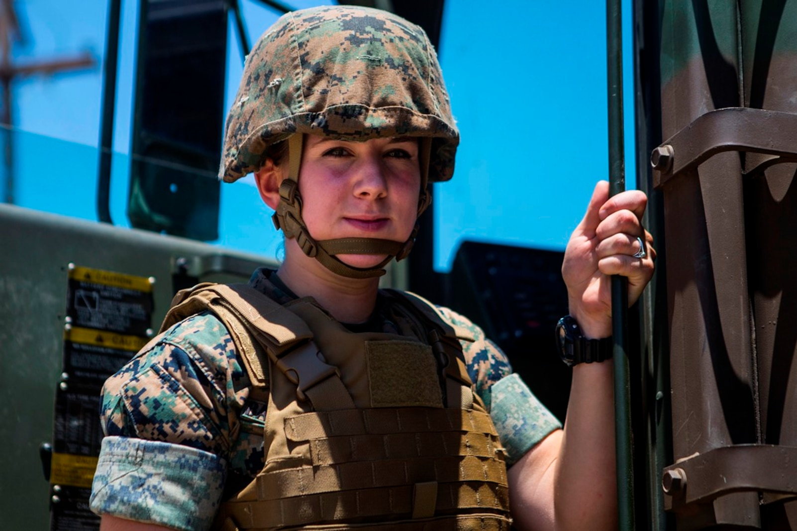 U.S. Marine Pfc. Heather Bartulewicz, a motor transport operator with Headquarters Regiment, 1st Marine Logistics Group, poses for a picture before climbing into a Medium Tactical Vehicle Replacement MK23 truck as she prepares to transport mission essential gear from one location to the next on Camp Pendleton, Calif., June 20, 2017. Motor Transport operators maintain and operate both commercial and tactical vehicles and are responsible for the transportation of everything from supplies and resources, to Marines and their equipment. (U.S. Marine Corps photo by Lance Cpl. Joseph Sorci)
