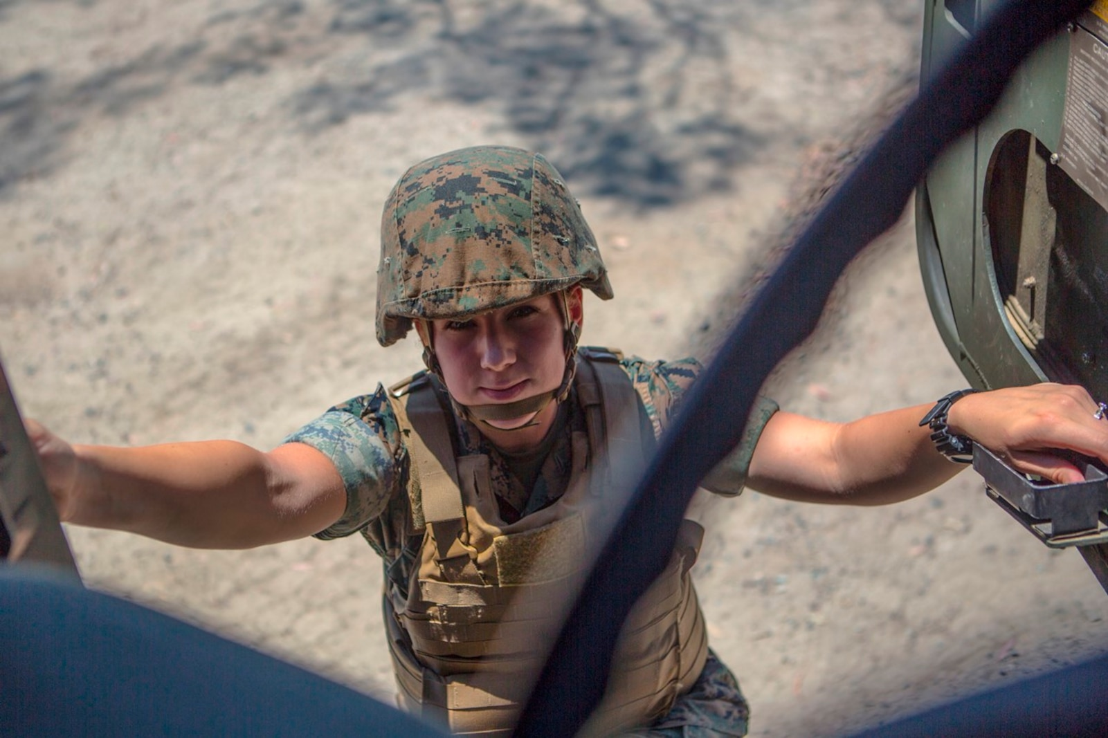 U.S. Marine Pfc. Heather Bartulewicz, a motor transport operator with Headquarters Regiment, 1st Marine Logistics Group, climbs into a Medium Tactical Vehicle Replacement MK23 truck as she prepares to transport mission essential gear from one location to the next on Camp Pendleton, Calif., June 20, 2017. Motor Transport operators maintain and operate both commercial and tactical vehicles and are responsible for the transportation of everything from supplies and resources, to Marines and their equipment. (U.S. Marine Corps photo by Lance Cpl. Joseph Sorci)