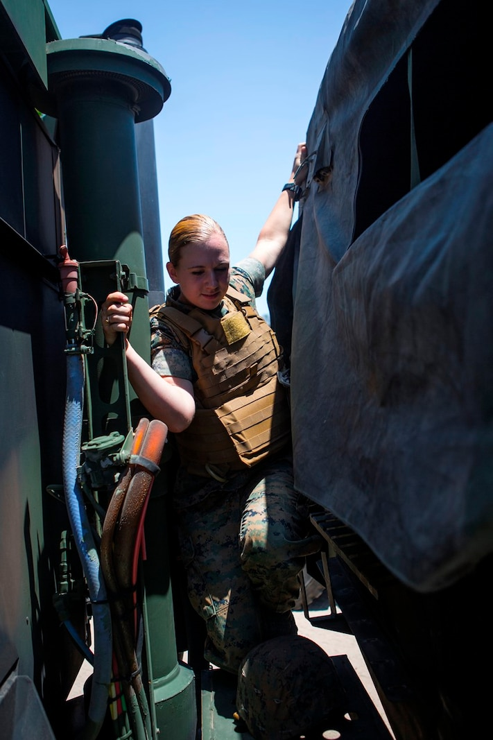 U.S. Marine Pfc. Heather Bartulewicz, a motor transport operator with Headquarters Regiment, 1st Marine Logistics Group, checks wires, lights and hook ups of a Medium Tactical Vehicle Replacement MK23 truck as she prepares to transport mission essential gear from one location to the next on Camp Pendleton, Calif., June 20, 2017. Motor Transport operators maintain and operate both commercial and tactical vehicles and are responsible for the transportation of everything from supplies and resources, to Marines and their equipment. (U.S. Marine Corps photo by Lance Cpl. Joseph Sorci)