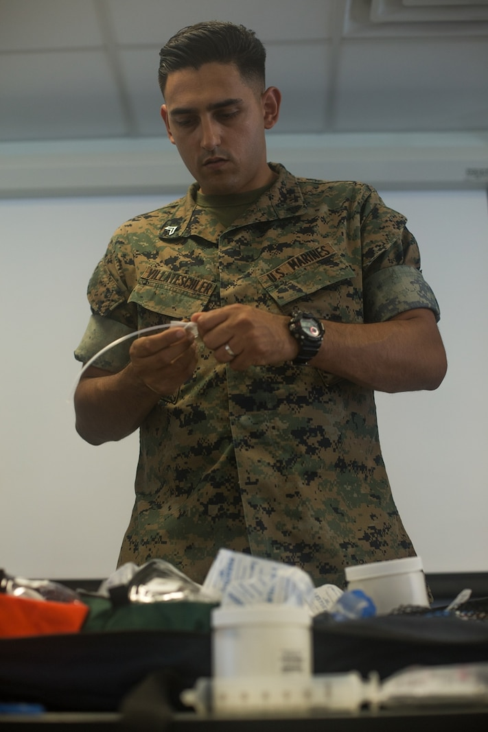 U.S. Marine Corps Cpl. Anthony Villateschler, a Chemical, Biological, Radiological, and Nuclear Defense (CBRN) specialist with Headquarters Company, Combat Logistics Regiment 1, 1st Marine Logistics Group (MLG), wraps parafilm onto a syringe tube during a Dismount Recon Sets Kit and Outfits (DRSKO) course on Camp Pendleton, Calif., June 13, 2017. The training was hosted by the CBRN Marines from 1st MLG. The purpose of the training was to provide familiarization on the new DRSKO equipment to CBRN Marines from across I Marine Expeditionary Force.