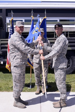 Col. Ken Ohlson (left),10th Mission Support Group commander, hands Lt. Col. Marcus Corbett the 10th Security Forces Squadron guidon June 21, 2017 at the 10th SFS change of command ceremony at the U.S. Air Force Academy. (U.S. Air Force photo/Mile Kaplan)