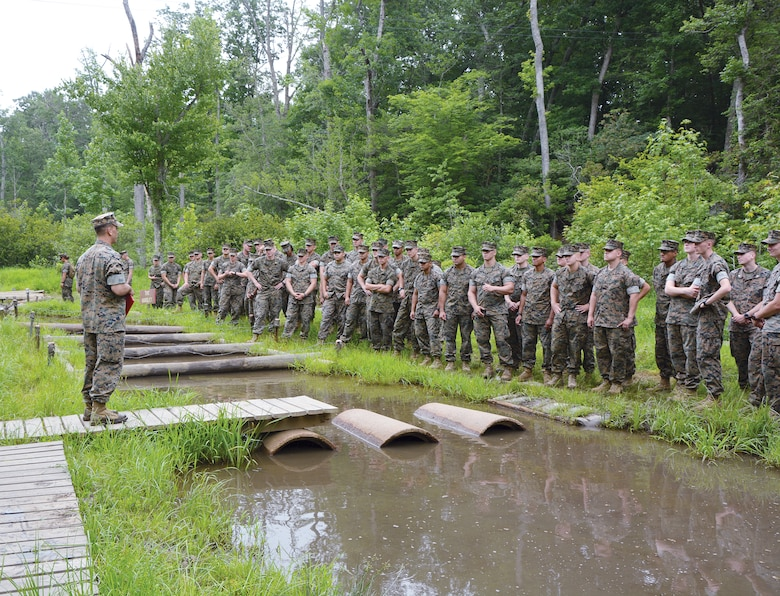"""Marines at Officer Candidates School recently celebrated the 50th anniversary of """"The Quigley"""", a rigorous obstacle course that has stood the test of time since 1967."""