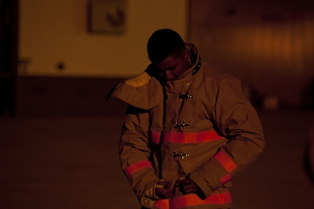 A U.S. Marine assigned to the Fire Protection Apprentice Course, Marine Detachment Goodfellow, prepares his gear to conduct ladder training exercises at Joint Airforce Base Goodfellow, Texas, March 24, 2017. The mission of Marine Detachment Goodfellow is to train Marines in the occupational fields of Fire Protection and Signals Intelligence for the Fleet Marine Force. (U.S. Marine Corps photo by Lance Cpl. Jose Villalobosrocha)