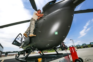 New Jersey Army National Guardsmen perform maintenance and systems checks on a UH-72 Lakota helicopter at Joint Base McGuire-Dix-Lakehurst, N.J., June 14, 2017. New Jersey Air National Guard photo by Master Sgt. Matt Hecht