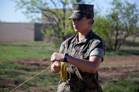 U.S. Marine Corps Pfc. Sydney I. Munn, a student assigned to the Tactical Signals Intelligence Operators Course, Marine detachment Goodfellow, sets up a 8 Meter Collapsable Mast Assembly at Joint Airforce Base Goodfellow, Texas, March 24, 2017. The mission of Marine Detachment Goodfellow is to train Marines in the occupational fields of Fire Protection and Signals Intelligence for the Fleet Marine Force. (U.S. Marine Corps photo by Lance Cpl. Jose Villalobosrocha)