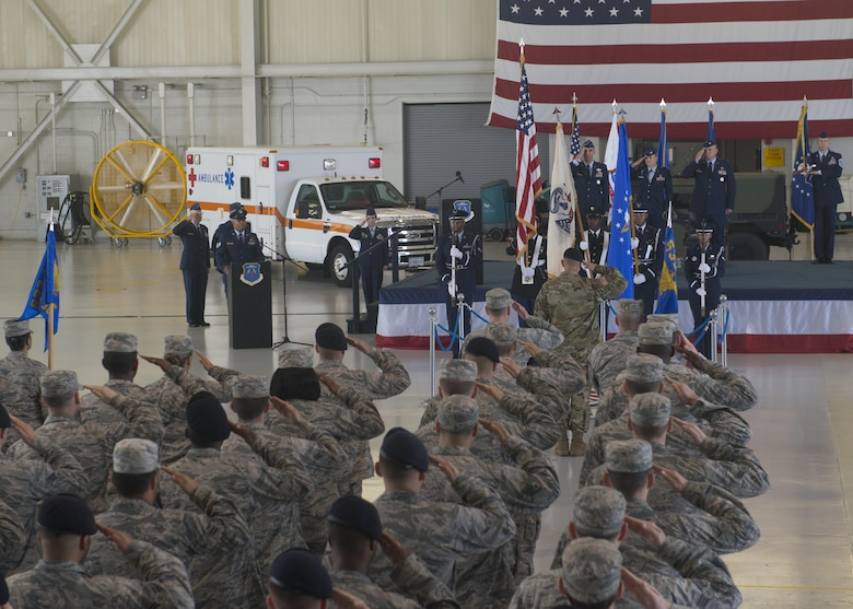 U.S. service members salute during a rendition of the national anthem at the 633rd Air Base Wing change of command ceremony Joint Base Langley-Eustis, Va., June 22, 2017. U.S. Air Force Col. Sean Tyler assumed command of the unit, which provides installation support to more than 18,000 Airmen, Soldiers and civilians across two major command headquarters, 13 operational wings and Army brigades, and more than 20 associate units. (U.S. Air Force photo/Staff Sgt. R. Alex Durbin)