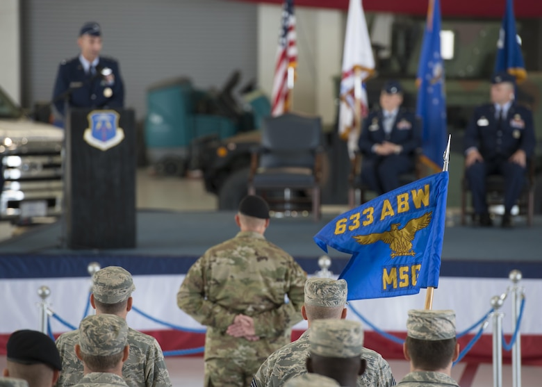 U.S. service members stand in formation during the 633rd Air Base Wing change of command ceremony at Joint Base Langley-Eustis, Va., June 22, 2017. The incoming commander, U.S. Air Force Col. Sean Tyler, previously served at Langley in a variety of positions throughout his career, including as a flight commander, executive officer and deputy group commander. (U.S. Air Force photo/Staff Sgt. R. Alex Durbin)