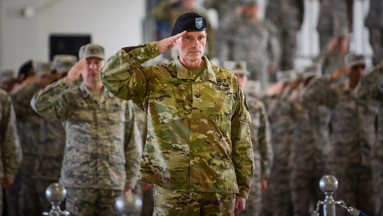 U.S. Army Col. Herbert Joliat, 633rd Air Base Wing vice commander, leads the command's service members in offering a salute as the national anthem plays during the 633rd ABW change of command ceremony at Joint Base Langley-Eustis, Va., June 22, 2017. U.S. Air Force Col. Sean Tyler assumed command from U.S. Air Force Col. Caroline Miller after two years of service. (U.S. Air Force photo/Staff Sgt. Areca T. Bell)