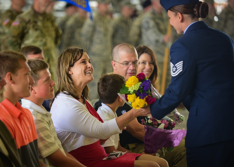 Sheri Tyler, wife of U.S. Air Force Col. Sean Tyler, 633rd Air Base Wing commander, receives a gift during the 633rd ABW change of command ceremony at Joint Base Langley-Eustis, Va., June 22, 2017. Tyler assumed command from U.S. Air Force Col. Caroline Miller and previously served at Langley in a variety of positions throughout his career, including as a flight commander, executive officer and deputy group commander. (U.S. Air Force photo/Staff Sgt. Areca T. Bell)