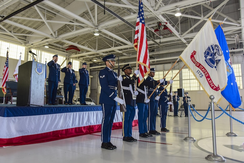 Joint honor guard members present the colors during the 633rd Air Base Wing change of command ceremony at Joint Base Langley-Eustis, Va., June 22, 2017. U.S. Air Force Col. Caroline Miller relinquished command to Col. Sean Tyler after two years of service. (U.S. Air Force photo/Airman 1st Class Tristan Biese)