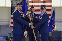 U.S. Air Force Col. Caroline Miller, 633rd Air Base Wing former commander, relinquishes command to Maj. Gen. Scott J. Zobrist, 9th Air Force commander, during the 633rd ABW change of command ceremony at Joint Base Langley-Eustis, Va., June 22, 2017. Miller served two years as commander of the 633rd ABW. (U.S. Air Force photo by Airman 1st Class Tristan Biese)