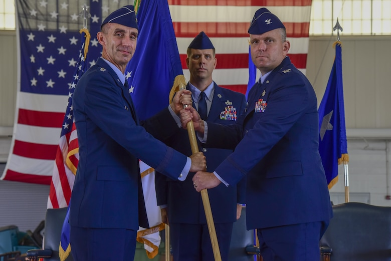 U.S. Air Force Maj. Gen. Scott J. Zobrist, 9th Air Force commander, passes command to Col. Sean Tyler, 633rd Air Base Wing incoming commander, during a change of command ceremony at Joint Base Langley-Eustis, Va., June 22, 2017. Tyler assumed command after serving as the Defense Logistics Agency executive officer to the director, Fort Belvoir, Va. (U.S. Air Force photo by Airman 1st Class Tristan Biese)