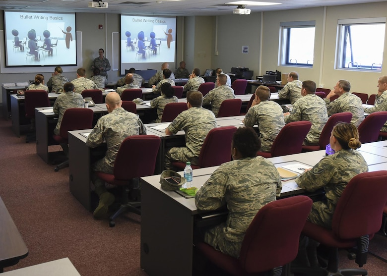 Chief Master Sgt. Paula C. Shawhan, chief of the I.G. Brown Training and Education Center, Professional Continuing Education division, teaches bullet writing to Airmen at the Maryland Air National Guard's 175th Wing, June 20, 2017, in Middle River, Md. The two-hour class teaches the fundamental dynamics on how to write an effective bullet statement for enlisted performance reports and officer performance
