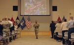 Army Brig. Gen. Charles Hamilton, DLA Troop Support commander, gets a standing ovation at the conclusion of his final workforce town hall June 20. Earlier, he played a video in which customers from around the world thanked Troop Support employees for their support.