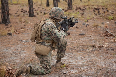 A U.S. Marine assigned to Advanced Infantry Training Battalion the School of Infantry-East (SOI-E), engage a simulated enemy position during a combined arms exercise at Camp Lejeune, N.C., April 7, 2017. The mission of SOI-E is to train entry-level and advanced level Marines in the skills required of an infantry Marine for the operating forces. (U.S. Marine Corps photo by Lance Cpl. Tyler Pender)