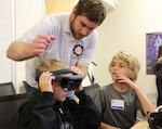 A group of about 23 middle school-aged military children had a chance to learn inspiring and exciting lessons about military medical science using virtual and augmented reality during a June 3-4 workshop held at the Uniformed Services University of the Health Sciences in Bethesda, Md. Uniformed Services University of the Health Sciences photo by Sharon Holland