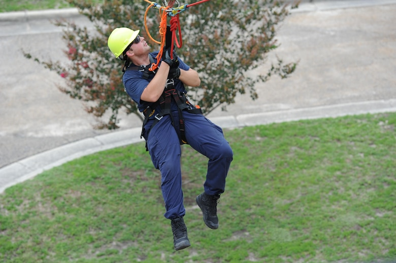Taylor Beesley, Biloxi Firefighter, participates in a controlled descent exercise from atop of the Weather Training Complex during rope rescue operations training June 14, 2017, on Keesler Air Force Base, Miss. Keesler hosted the advanced rescue certification training course, which consisted of confined space rescue, high and low angle rescue and stokes basket rescue operations, for Keesler and Biloxi Firefighters. (U.S. Air Force photo by Kemberly Groue)