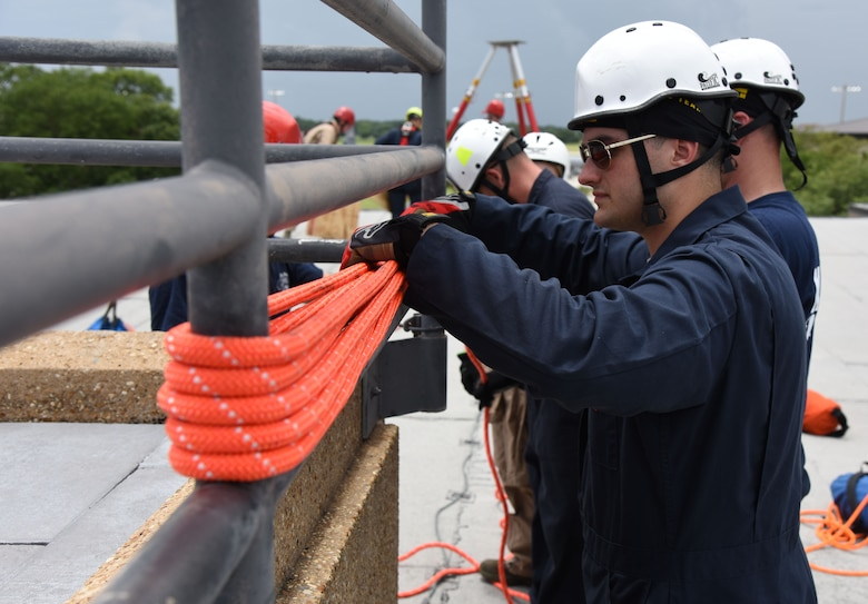 Senior Airman Chase Dillon, Keesler Firefighter, secures a rope for a controlled descent exercise atop of the Weather Training Complex during rope rescue operations training June 14, 2017, on Keesler Air Force Base, Miss. Keesler hosted the advanced rescue certification training course, which consisted of confined space rescue, high and low angle rescue and stokes basket rescue operations, for Keesler and Biloxi Firefighters. (U.S. Air Force photo by Kemberly Groue)