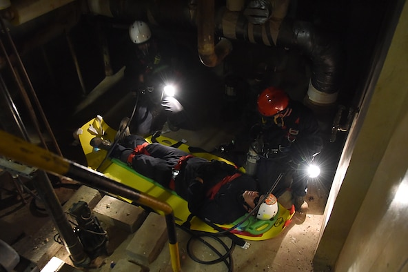 Members of the Keesler and Biloxi Fire Departments participate in confined space rescue operations training in the Keesler Medical Center June 16, 2017, on Keesler Air Force Base, Miss. Keesler hosted the advanced rescue certification training course, which consisted of confined space rescue, high and low angle rescue and stokes basket rescue operations. (U.S. Air Force photo by Kemberly Groue)