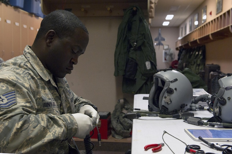 U.S. Air Force Technical Sgt. Warren Binyard, the 36th Fighter Squadron noncommissioned officer in charge of aircrew flight equipment, disassembles parts of an oxygen mask June 21, 2017, at Eielson Air Force Base, Alaska. The equipment that Binyard maintains is essential to pilots due to the high altitude at which they fly. (U.S. Air Force photo by Airman Eric M. Fisher)