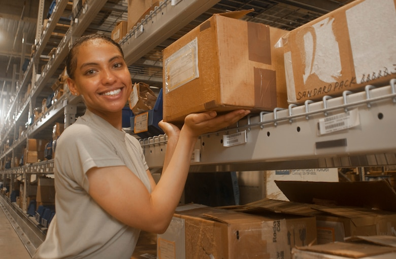 U.S. Air Force Senior Airman Serah Lewis, 18th Logistics Readiness Squadron material management specialist, displays one of the boxes in the central warehouse June 22, 2017, at Kadena Air Base, Japan. The 18th LRS is one of the largest logistics squadrons in the Pacific Air Force. (U.S. Air Force photo by Senior Airman Quay Drawdy)