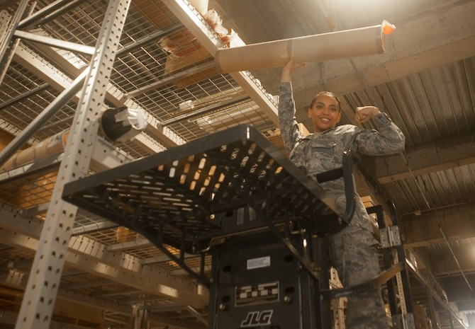 U.S. Air Force Senior Airman Serah Lewis, 18th Logistics Readiness Squadron material management specialist, searches for an item June 22, 2017, at Kadena Air Base, Japan. Airmen from the 18th LRS provide logistical support for every unit on Kadena and several more across Okinawa. (U.S. Air Force photo by Senior Airman Quay Drawdy)