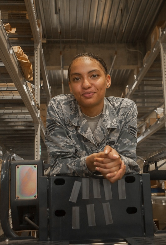 U.S. Air Force Senior Airman Serah Lewis, 18th Logistics Readiness Squadron material management specialist, stands for a photo June 22, 2017, at Kadena Air Base, Japan. The 18th LRS material management specialists ensure customers who visit the central warehouse are able to leave with the parts they need to complete their missions. (U.S. Air Force photo by Senior Airman Quay Drawdy)